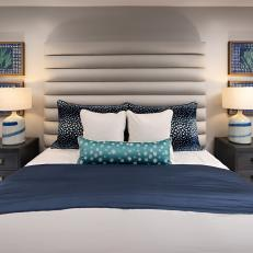 Contemporary Gray Bedroom With Blue Pillows