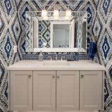 Blue Powder Room With Geometric Wallpaper