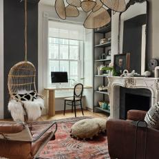 Eclectic Sitting Room With Hanging Chair