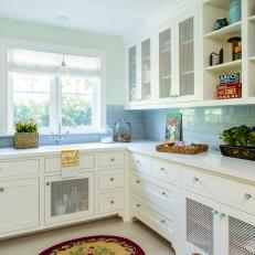 Shabby Chic Laundry Room With Blue Knobs