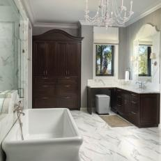 Primary Bathroom in Dark Wood and Marble