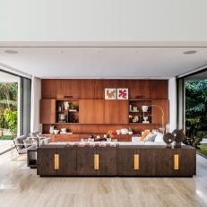 Walnut Millwork and Natural Stone in Open-Concept Living Area