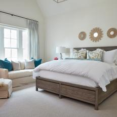 Spacious, Neutral Bedroom With Vaulted Ceiling
