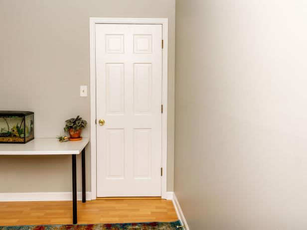 A white door in a bedroom