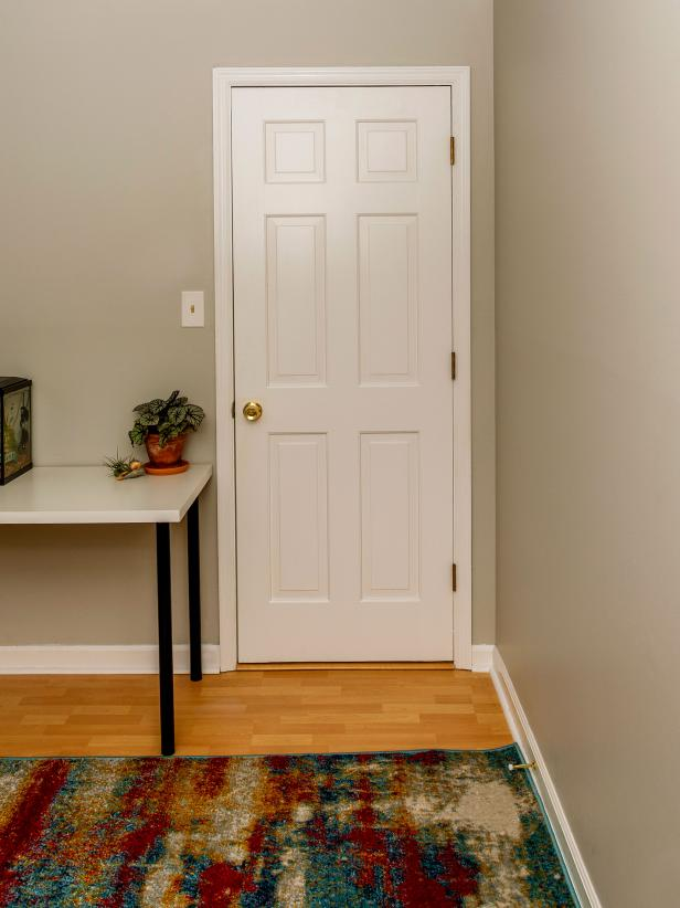 A white door in a room.