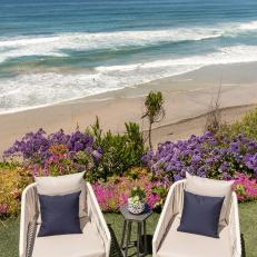 White Outdoor Armchairs and Beach
