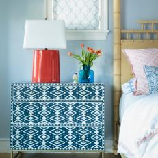 Patterned Dresser and Red Lamp