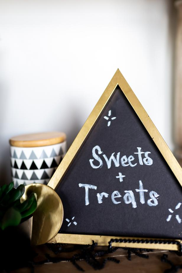 Wooden DIY Chalkboard Menu on Table Says Sweets and Treats