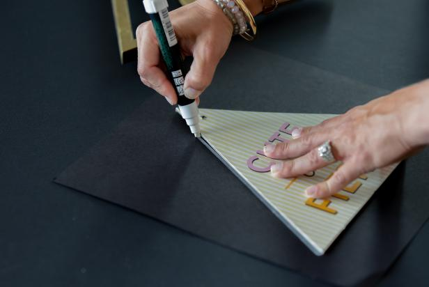 Trace the triangular shape onto the card stock with a chalk marker. Then cut out the shape with scissors.