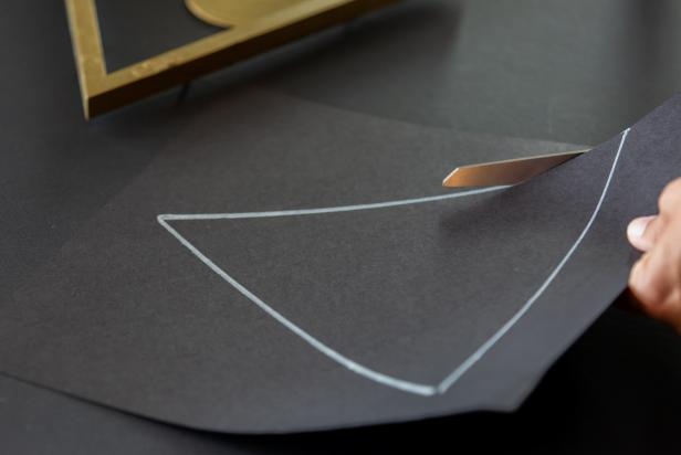 Use the art backing as a template. Now, trace and cut out the triangle shape.