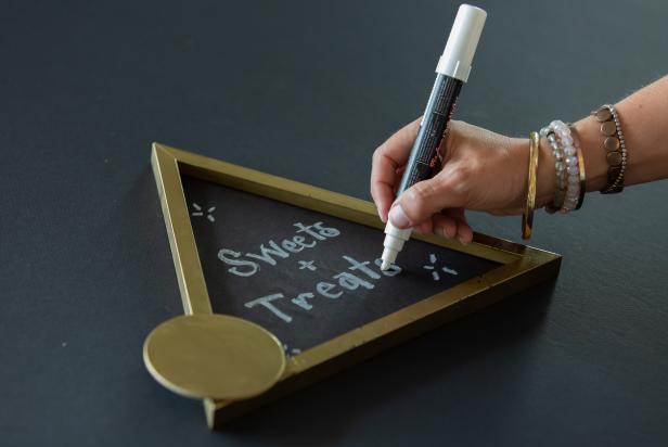 Write a custom message on the new DIY sign with a chalk marker.