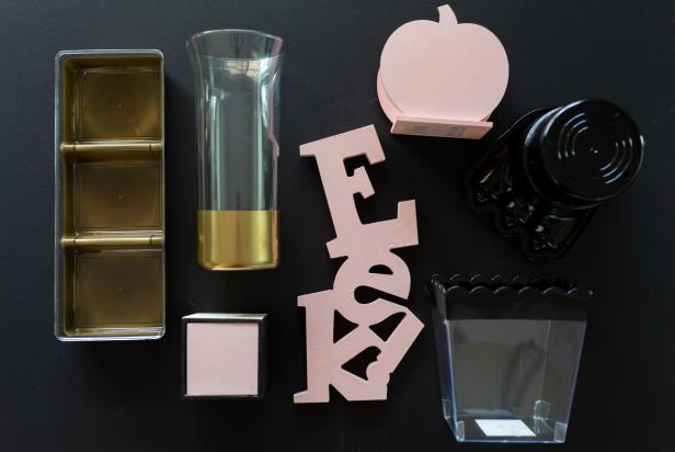 Gold Plastic Vases, Tin, Pink Wood Letters, Pumpkin on Work Table