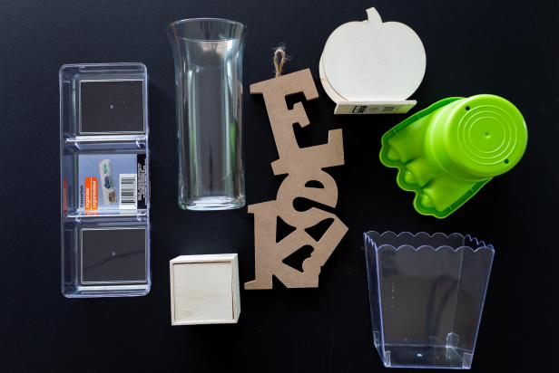 Spray paint a mixture of items to create a consistent theme, like these clear plastic vases, wooden letters and boxes.