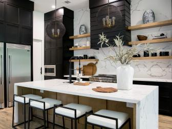 Black and White Modern Chef Kitchen With White Stools