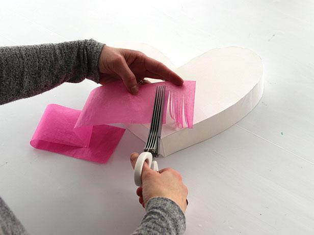Cut strips of tissue paper with fringe scissors, leaving about a half-inch uncut at the top.