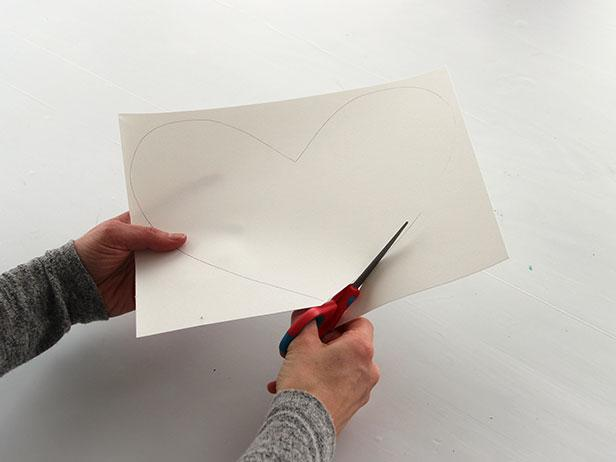 On another piece of card stock, use the first heart as a template to trace an identical one and cut it out.
