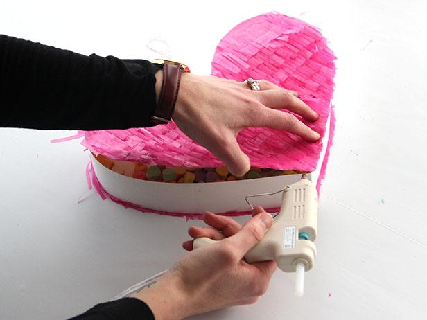 Fill the heart with candy and seal up the opening using a hot glue gun.