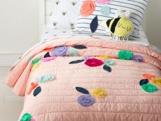 Create a haven that's tailored just for your kiddo with cozy, colorful bedding, bright lighting, fun artwork and charming rugs.